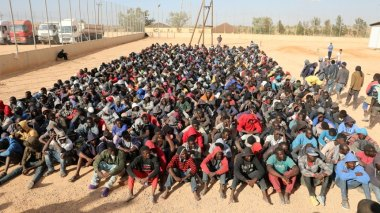 Migrants sit at a detention center in Gharyan, Libya October 12, 2017. REUTERS/Hani Amara TPX IMAGES OF THE DAY - RC1EF5997D70